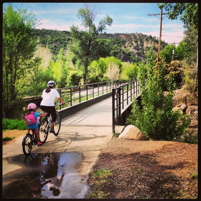 Angela towing Lucy on the Animas River Trail